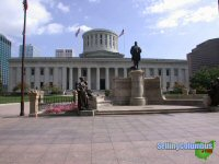 The State Capital building in downtown Columbus, Ohio with statues out in front.